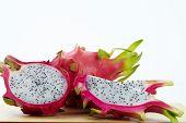 foto of dragon fruit  - dragon fruit slicing on chop block in white background - JPG