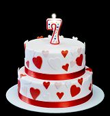 foto of number 7  - Birthday cake and number 7 isolated on a black background - JPG