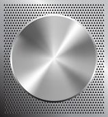 stock photo of metal grate  - Metallic disc on perforated grey technology background - JPG