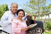 picture of mailbox  - Senior Hispanic Couple Checking Mailbox - JPG