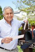 stock photo of mailbox  - Senior Hispanic Man Checking Mailbox - JPG