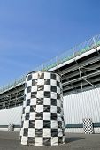 picture of grandstand  - checkered trash cans outside a sports arena grandstand - JPG