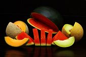 stock photo of muskmelon  - Fresh organic melons on a black background - JPG