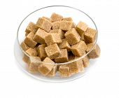 stock photo of sugar  - Brown sugar in a glass sugar bowl isolated on a white background - JPG