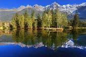 stock photo of snow capped mountains  - Dreamlike beauty lake and park - JPG