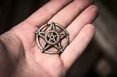 picture of pentagram  - Old steel Pentagram closeup photo on background - JPG
