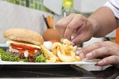 stock photo of hamburger  - Chef decorated Hamburger and French Freid  - JPG