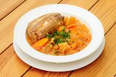 stock photo of stew  - Stewed cabbage and other vegetables with pork meat - JPG