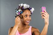 pic of african american hair styles  - An African American woman putting on makeup - JPG
