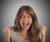 image of scream  - Aggressive businesswoman stressed out from work screams - JPG