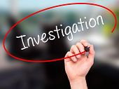 picture of investigation  - Man Hand writing Investigation with marker on transparent wipe board - JPG