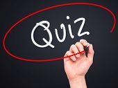 picture of quiz  - Man Hand writing Quiz with marker on transparent wipe board - JPG