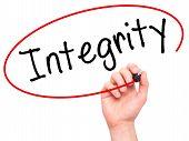 image of integrity  - Man Hand writing Integrity black marker on visual screen - JPG