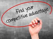 picture of competition  - Man Hand writing Find your competitive advantage with marker on transparent wipe board - JPG