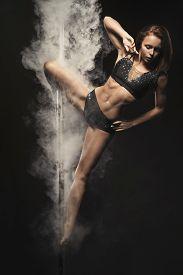 stock photo of light-pole  - Young sexy woman pole dance woman - JPG