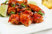 pic of chicken wings  - Wing dings glazed with a spicy asian sauce - JPG