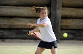 Young Girl Playing Tennis Hitting A Forehand
