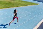 Runner sprinting towards success on run path running athletic track. Goal achievement concept. Femal poster