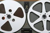 stock photo of ferrite  - open reel audio tape deck reels close up - JPG