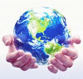 pic of healing hands  - A pair of hands hold a globe with white background - JPG