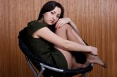 picture of panty-tights  - sad pensive girl in torn tights studio photography - JPG