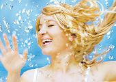 Young blond woman enjoying water