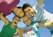 image of family fun  - Young family is playing around on a sunny day - JPG
