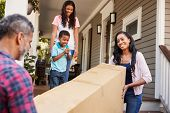 Family Carrying Big Box Purchase Into House poster