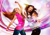 image of laser beam  - two young girls dancing in discolight - JPG