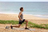 Fitness man doing lunges leg exercise lunge exercising legs. Male fitness model doing alternating bo poster