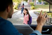 Father In Car Dropping Off Daughter In Front Of School Gates poster