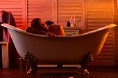 Sex And Relaxation Concept: Guy With Book In Bathtub poster