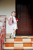 picture of bagpack  - Young school girl with pink bagpack waits standing on stairs - JPG