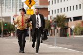 stock photo of budge  - Competitive businessmen rush to pass - JPG