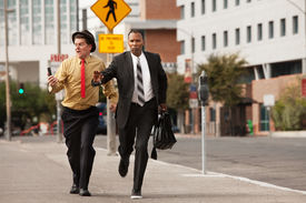 pic of budge  - Competitive businessmen rush to pass - JPG