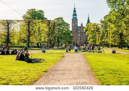 poster of People Relaxing At The King's Garden Next To Rosenborg Castle
