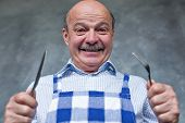 Senior Hispanic Hungry Man Holding A Fork And A Knife. poster