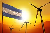 Honduras Wind Energy, Alternative Energy Environment Concept With Turbines And Flag On Sunset - Alte poster
