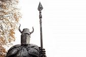 Medieval Knight In Armor And With A Spear, Copy The Space To The Right. Helmet With Horns. poster