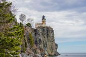 Split Rock Lighthouse With Clouds	On Lake Superior poster
