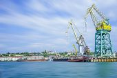 Seascape With The Coastline Of The Port And Large Floating Cranes. The Photo Was Taken At A Long Exp poster