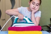Iron In The Hand Of The Girl On The Ironing Board Irons And Steams Clothes poster