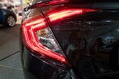 Detail On The Rear Light Of A Black.  Black Sport Hybrid Car Rear Light Parts. Tail Light Of Luxury  poster