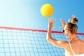 Volleyball In Beach. Young Girl Playing Volleyball In The Beach. poster