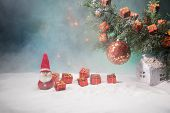 Christmas Decoration - Bauble On Branch Of Pine Tree With Holiday Attributes On Snow. Selective Focu poster