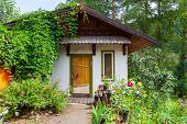A Small Cute House Outside The City For Summer Living And Outdoor Recreation Around Which There Is A poster