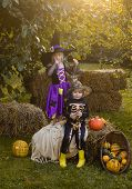 Happy Kids On Halloween Party. Halloween Kids Holidays Concept. Children Sister And Brother With Pum poster