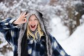 Winking Woman In Warm Coat, Hat Shows Sign Ok. Cold Winter Weather. Fashion Girl In Wintertime. Chri poster
