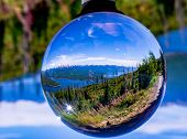 Lensball Image Of Hungry Horse Resrvoir With The Flathead Range Featuring Great Northern Mountain. poster
