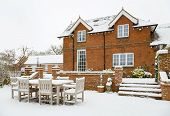 House And Patio In Snow In Winter In England, Uk poster